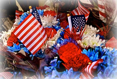 A Red, White and Blue Flower arrangement is a nice idea for a Veteran's Funeral Service