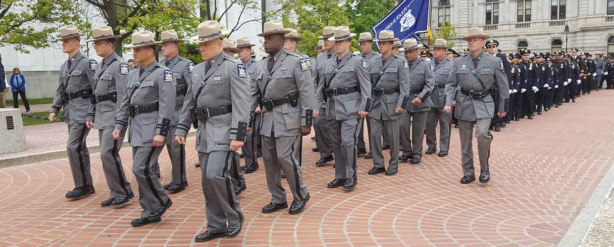 Police marching during 2017 NYS Police Officers Memorial Ceremony