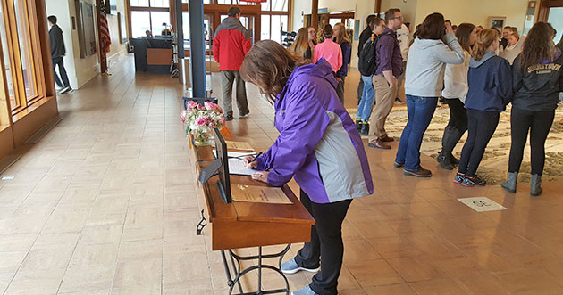 Bobbie Jo Senzio of Johnstown, NY writes in the condolence book for Barbara Bush at the FDR Library & Museum