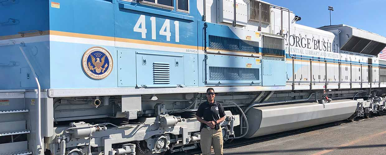 Master Sgt. Shana Cobbs poses for a photo in front of the George Bush 4141 Locomotive Dec. 3, 2018, in Spring, Texas.