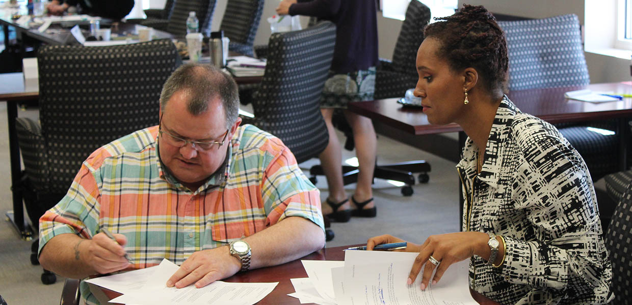 Fire service chaplain David King, of Toronto, and Holistic Wellness coach Cheryl-Elemi Gayle, of New Jersey, put final touches on a eulogy for a hypothetical funeral service as part of a team exercise during the In-Sight Certified Celebrant course held at the office of the New York State Funeral Directors Association in June 2015