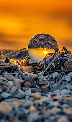Crystal sphere on the shore
