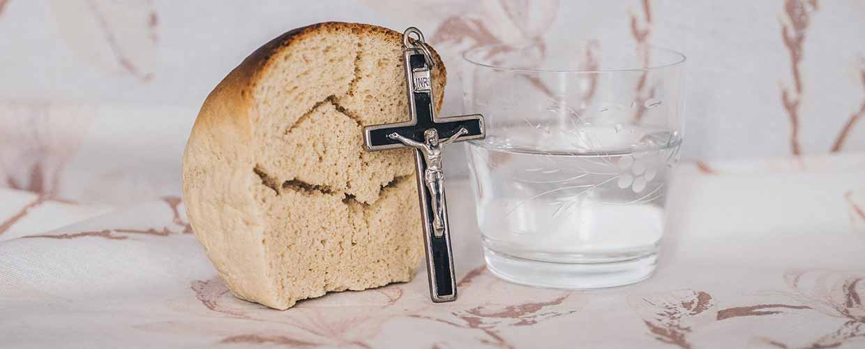 Crucifix, bread and water