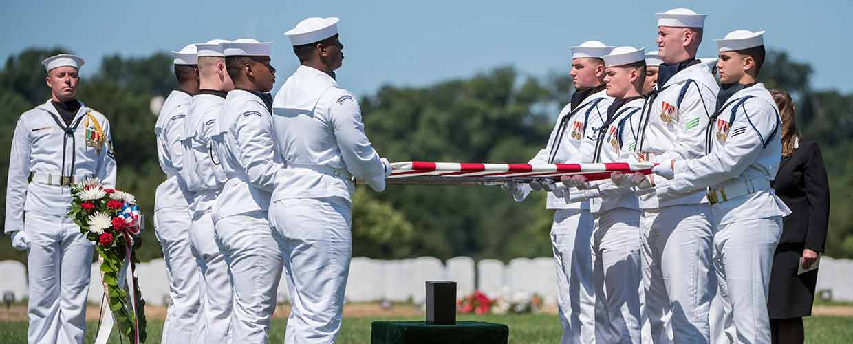 August 23, 2018 - Sailors from the U.S. Navy Ceremonial Guard hold the U.S. flag during the full honors funeral of U.S. Navy Lt. Commander William Liebenow in Section 62 of Arlington National Cemetery, Arlington, Virginia, August 23, 2018. On August 7, 1943, Liebenow skippered a patrol torpedo boat to rescue the sailors of PT-109 who had survived several days on inhospitable islands after a Japanese destroyer had rammed their boat, killing two crewmen. Among those rescued was Liebenow's bunkmate, John F. Kennedy, then 26. For his acts of heroism during World War II, he received the Bronze and Silver Stars. His wife, Lucy Liebenow, received the flag from his casket. (U.S. Army photo by Elizabeth Fraser / Arlington National Cemetery / released)