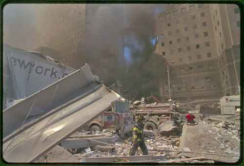 Firefighter works in aftermath of September 11, 2001 terrorist attack. Photo Courtesy of the Prints and Photographs Division, Library of Congress, from the collection of unattributed photographs of the September 11th terrorist attack on the World Trade Center, New York City.